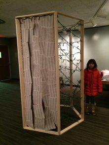 Another angle of the Booth, focusing on the door made of phone book pages.